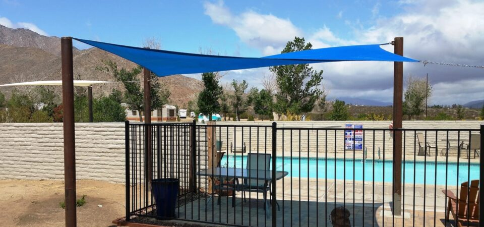 The pool area with a shade cover