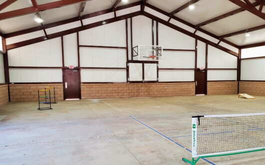 The interior of the Sport Court at Stagecoach Trails campground that includes basketball, pickleball, and yard games